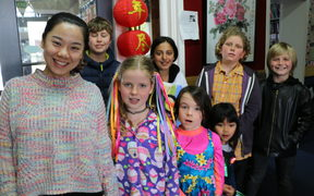 Te Aro Primary students with MLA Chinese teacher Jingwen Zhang.