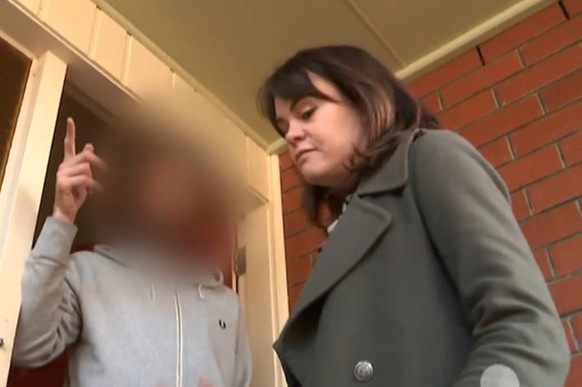 Heather du Plessis-Allen confronting an agent at his home.