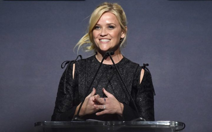 Reese Witherspoon speaks on stage during ELLE's 24th Annual Women in Hollywood Celebration.