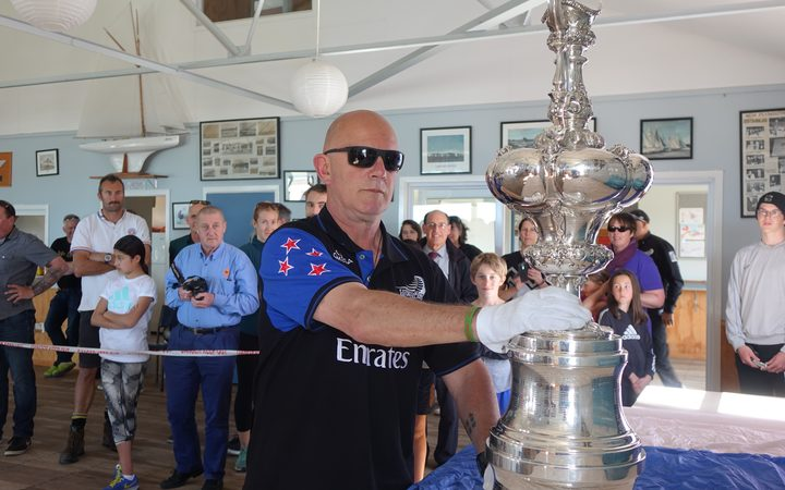 Norm Newton delivers the America's Cup to the New Plymouth Yacht Club.