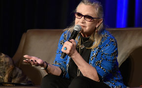 Actress Carrie Fisher speaks onstage during Wizard World Comic Con Chicago 2016. She died in December that year.