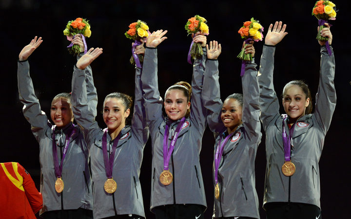 (From L) Gold medalist Team US Kyla Ross, Alexandra Raisman, Mckayla Maroney, Gabrielle Douglas and Jordyn Wieber celebrate on the podium of the women's team competition of the artistic gymnastics event of the London Olympic Games on July 31, 2012 at the 02 North Greenwich Arena in London.