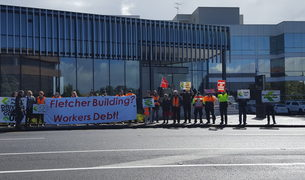 Protesters outside Fletcher Building headquarters in Auckland.