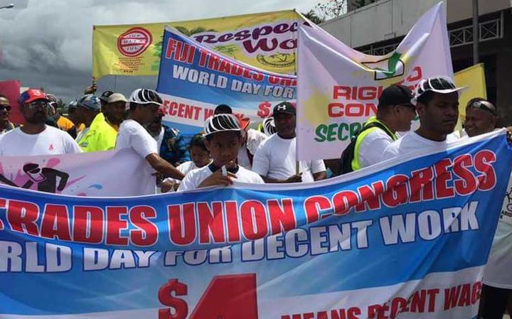 Workers marching for labour rights in Suva