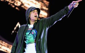Eminem performs at Samsung Galaxy stage during 2014 Lollapalooza Day One at Grant Park on August 1, 2014 in Chicago, Illinois.