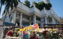 Flowers are laid at the entrance to the reopened Erawan Shrine in Bangkok.