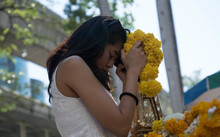 A woman prays at the reopened Erawan Shrine in Bangkok.