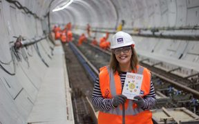 Laurie Winkless and her book in one of London's Cross Rail tunnels being built