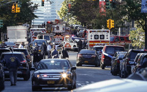 Emergency personal respond after reports of multiple people hit by a truck after it plowed through a bike path in lower Manhattan on October 31, 2017 in New York City.