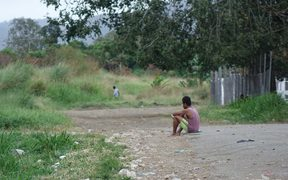 Aimless youth: a young Papua New Guinea man sits on the ground in Kwikila.