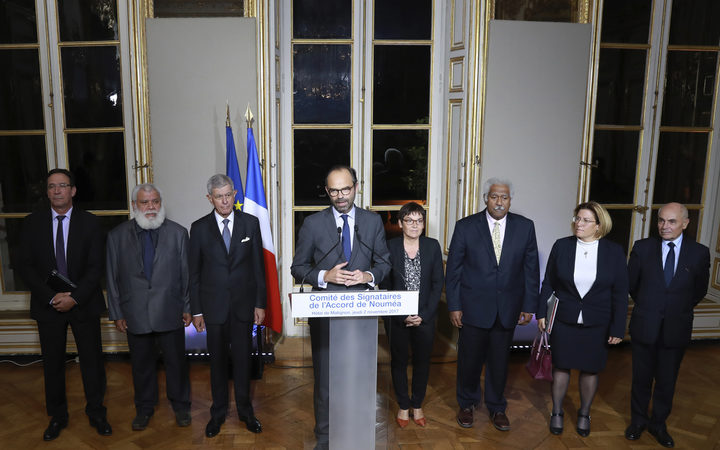 French Prime Minister Edouard Philippe (C), flanked by members of the Noumea Accord Signing Committee (Comite des Signataires.