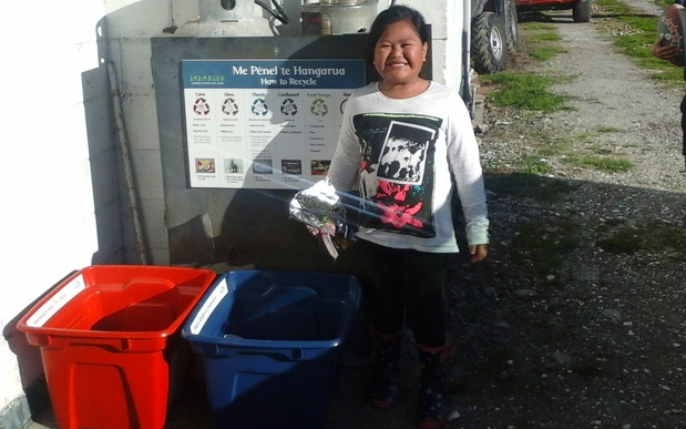 Tamariki get involved in recycling at Oturu Marae in Kaitaia.