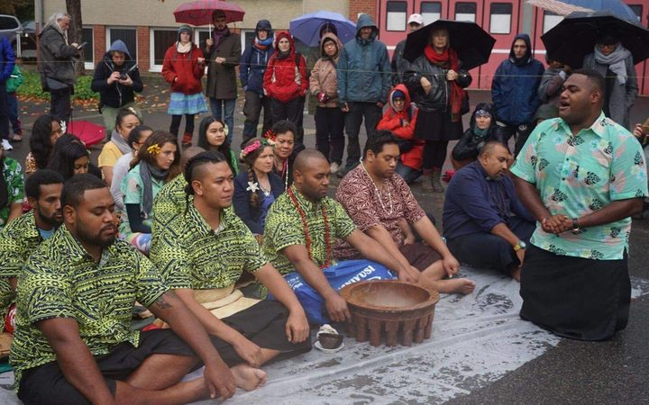 Pacific island climate change campaigners  hold a traditional Fijian sevusevu and offer tapa to a community impacted by a massive coal mine in Germany.