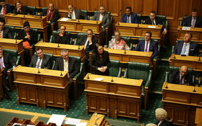 Prime Minister Jacinda Ardern, centre, and MPs were sworn in.