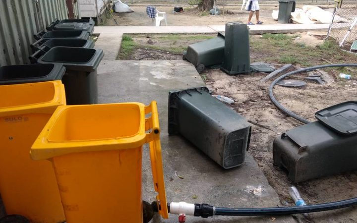 Overturned rubbish bins used to store rainwater.