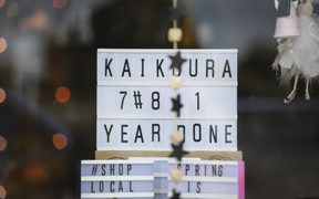 Locals call the Kaikoura earthquake anniversary, one year done. Sign in a retail shop on the main road, West End, Kaikoura.