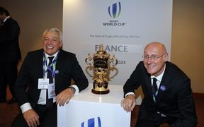 President of the French bid Claude Atcher (left) and French rugby President Bernard Laporte pose with the trophy after France was named to host the 2023 Rugby World Cup.