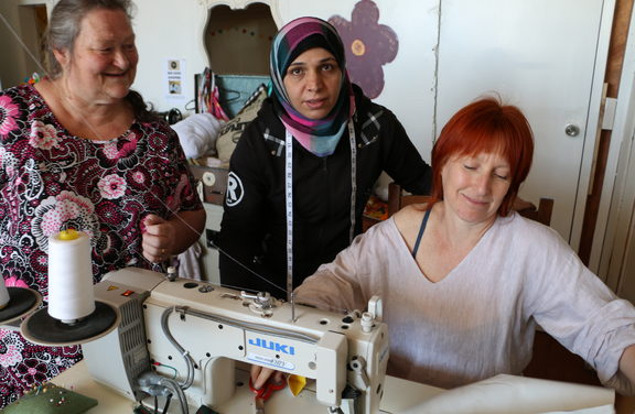 Sewing Tutor Linda (left), Sew Good mama Safaa and tutor Sally Gray at The Remakery, Wellington