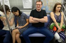Women crowded by 'Manspreading' on a New York Subway.