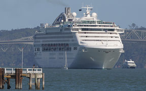 The Dawn Princess is moved into deeper water at Mission Bay on the east coast of Auckland after a tsunami alert on February 28, 2010.