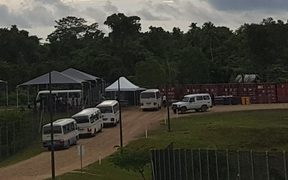 Buses taking people from the Manus detention centre to Lorengau
