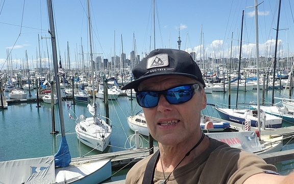 Bruce tests out his injury on a walk around the Auckland waterfront.