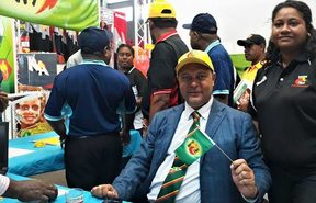 Bulolo MP Sam Basil inside the Pangu Pati's stall at a Political Parties Expo.