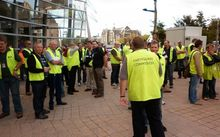 Earthquake Commission staff gather outside the Civil Defence headquarters on Thursday.