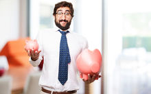 Man holding piggy banks