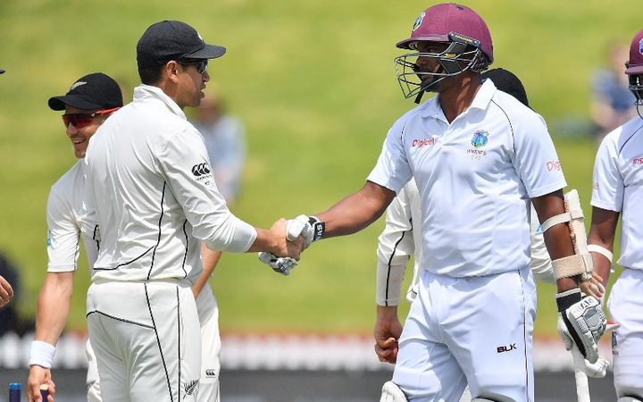 West Indies' Shannon Gabriel shakes hands with New Zealand's Ross Taylor after New Zealand's win during day four of the first Test cricket match.