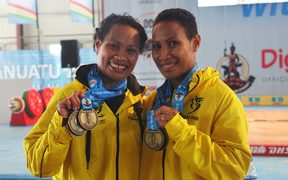 Papua New Guinea weightlifters Thelma and Dika Toua win the first gold medals at the Pacific Mini Games in Vanuatu. December 2017