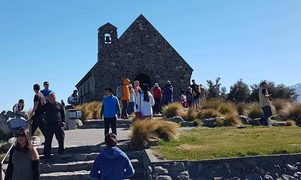 Tourists throng at the church in Tekapo.