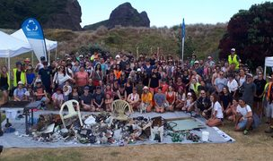 The Sustainable Coastline group and volunteers who helped with cleaning up West Auckland beaches and some of what they found.