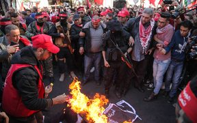 Protesters burn an effigy of US President Donald Trump as Palestinian Popular Front for the Liberation of Palestine supporters rally in Gaza City to protest against US President Donald Trump's decision to recognize Jerusalem as Israel's capital.