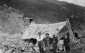 Chinese gold miners outside a dwelling in Macetown