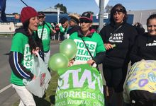 People wave balloons and banners at a protest at the Wairoa Bridge in Hawke's Bay over AFFCO employment contracts.