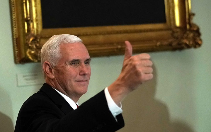 US Vice-President Mike Pence reacts to news sweeping tax reforms have been passed