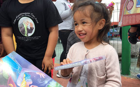 Waitangirua community Christmas Party. Locals received a free sausage sizzle, some received food hampers and christmas gifts were handed out to the children.
