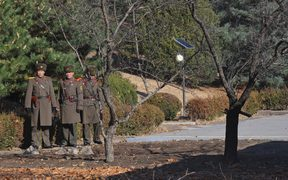 This file photo taken on November 27, 2017 shows North Korean soldiers staring at the South side at the truce village of Panmunjom in the DMZ.