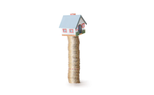 House balancing on money