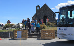 Tourists visit at the Church of the Good Shepherd in Tekapō.
