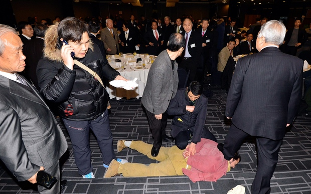 Political activist Kim Ki-Jong is arrested following his knife attack on US ambassador to South Korea Mark Lippert.