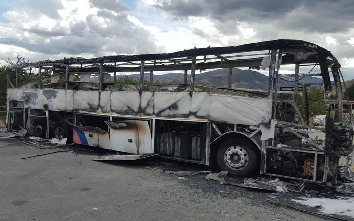 The bus that caught fire at the Mrs Jones fruit stall on the edge of Cromwell.