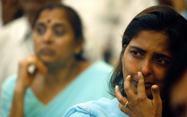 Vishakha Seksaria (right), who lost her brother Vrindesh in the 2006 blasts, weeps at a memorial function for the victims in Mumbai in 2007.