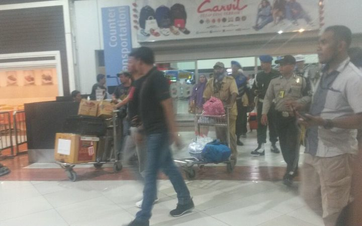 Filep Karma (centre with trolley) was taken in for questioning by police at Jakarta's Sukarno Hatta airport.