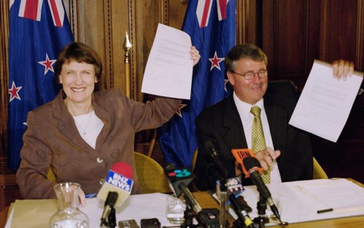Labour leader and Prime Minister Helen Clark and Jim Anderton, leader of the coalition partner the Alliance, hold up their coalition agreement in 1999.