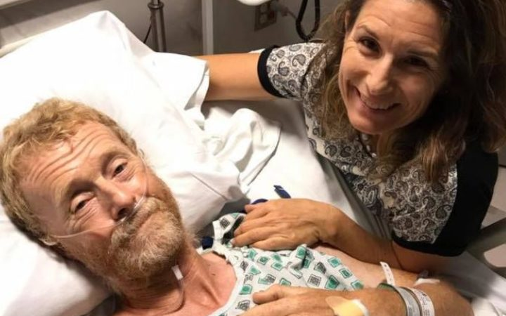 Nick Ashill pictured with his wife in hospital after being struck by a ute and left for dead on a US highway.