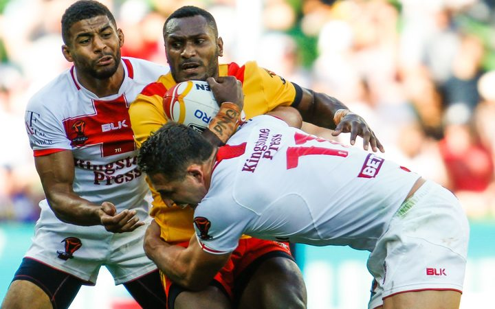 Kato Ottio is tackled during the England v PNG 2017 Rugby League World Cup Quarter Final