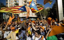 "Demonstrators wave ""Estelada"" flags (pro-independence Catalan flags) during celebrations of Catalonia's National Day."