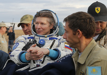 Expedition 44 crew member Gennady Padalka (centre) of Roscosmos is carried to the medical tent after landing in a remote area outside the town of Zhezkazgan in Kazakhstan on 12 September 2015.